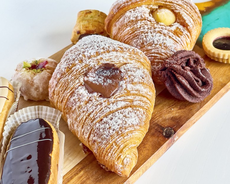 Crossiants and other pastries from Brunetti Classico on wooden board