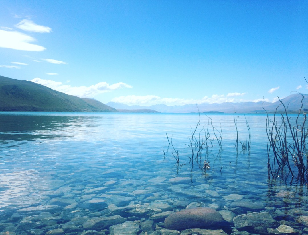 Calm waters at the lakefront in Tekapo, New Zealand
