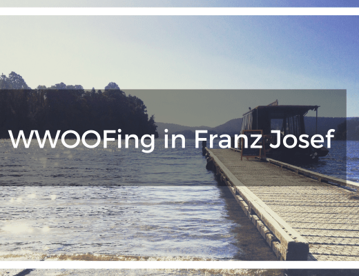 Title overlay text of a boat jetty in Franz Josef over Lake Mapourika with the sun bouncing off the water