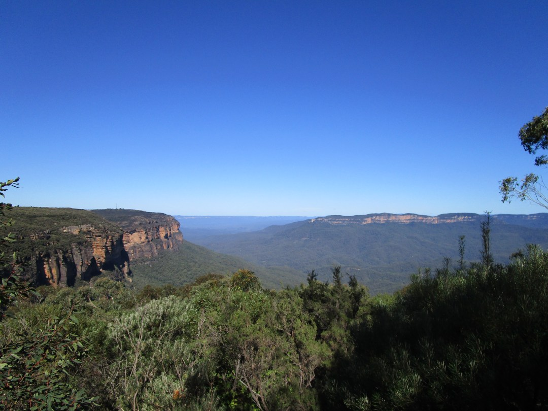 The Blue Mountains in Sydney Australia live up to their name by reflecting the blue skies and with stunning blue views across the thick forest in the distance