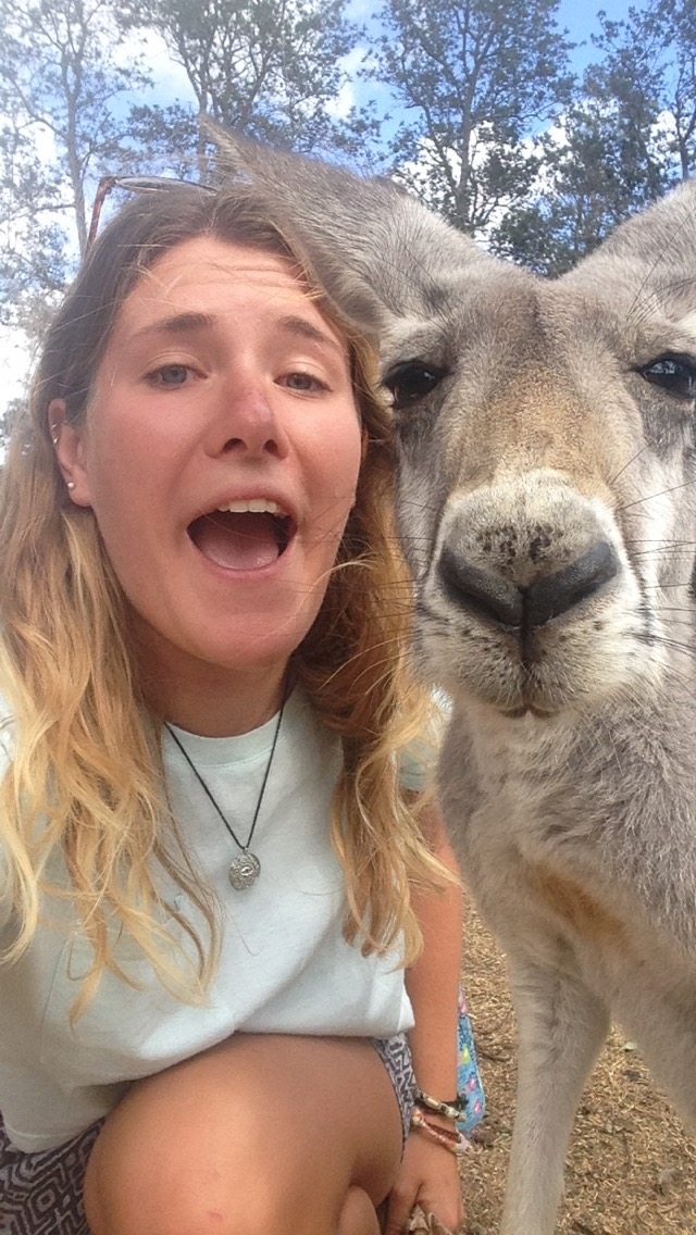 Girl and kangaroo take a selfie together