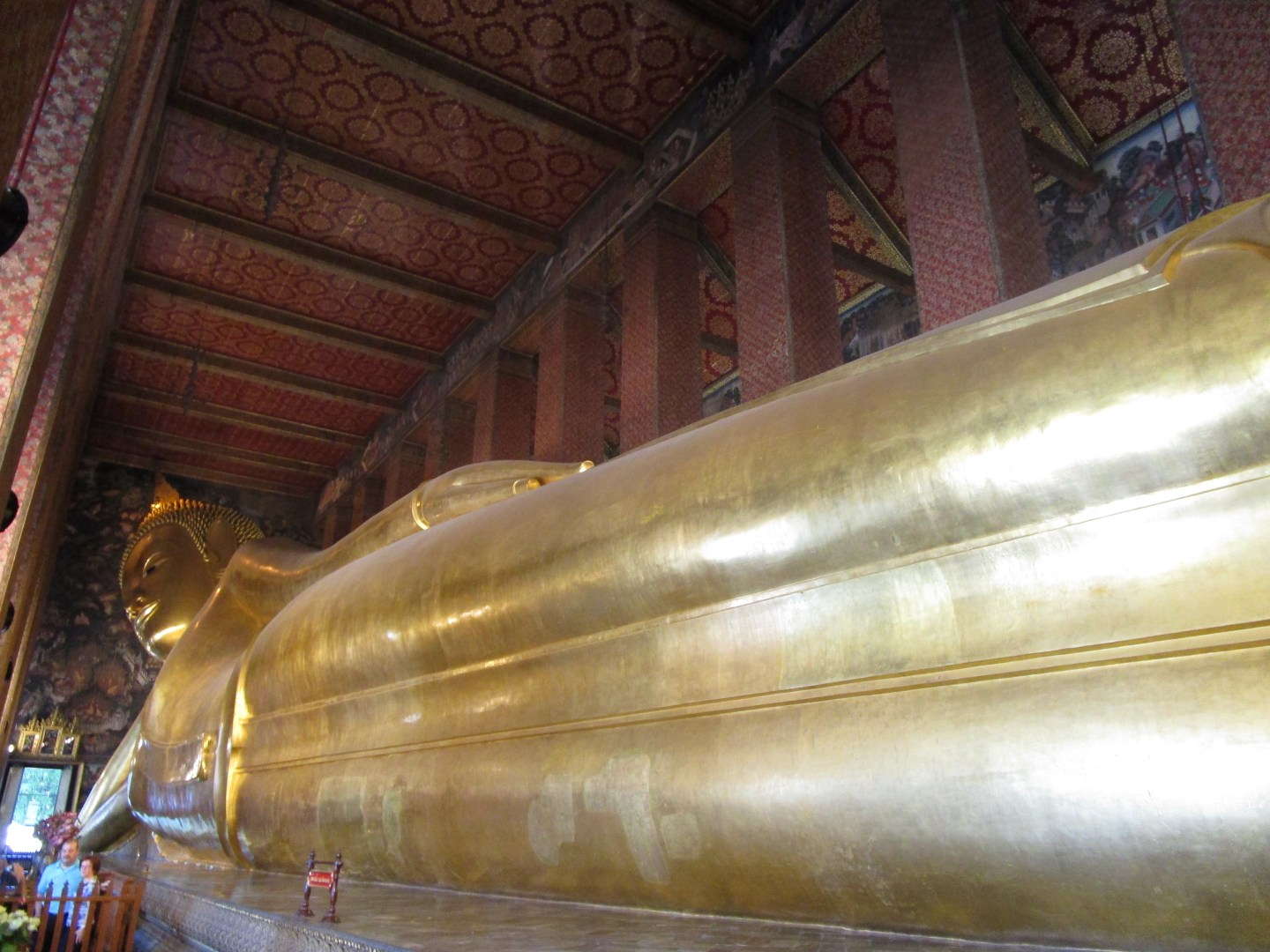 Reclining Buddha shows the enormity and length of a huge golden shrine