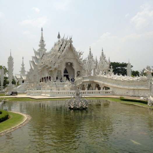 The full effect and magnitude of the White Temple with a pond in front