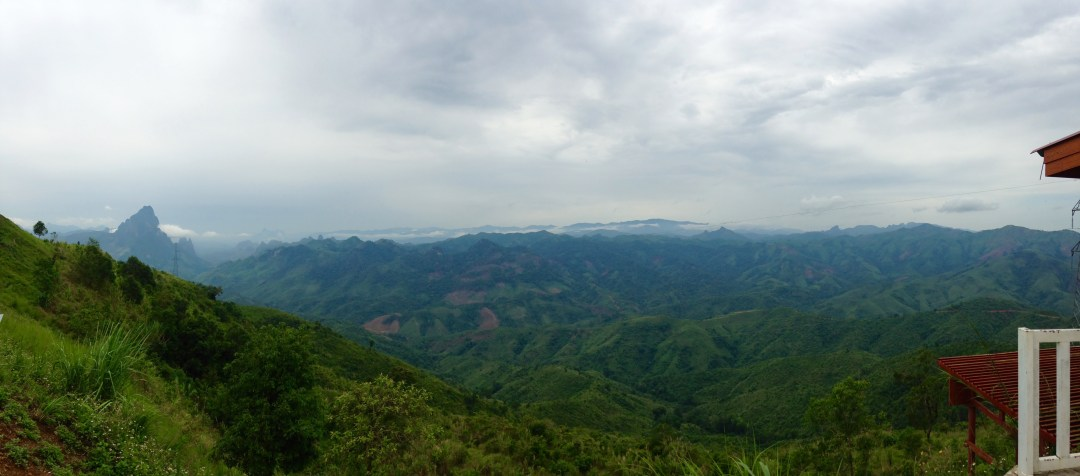 Cloudy skys over rolling green hills in the north of Laos