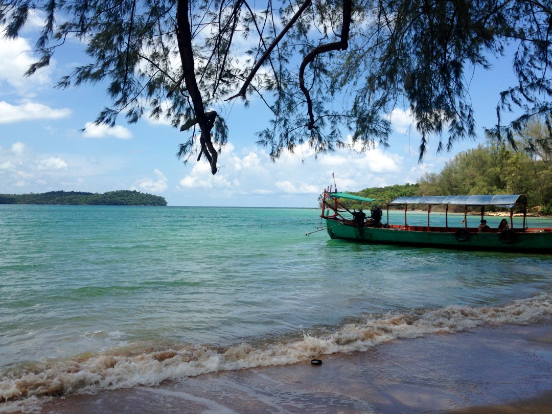 Docked boat overlooking perfect turquoise waters in Cambodia