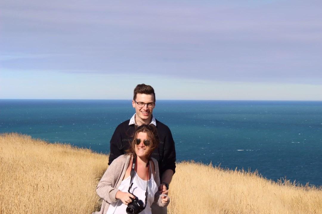 couple smile on coastal walk godley head