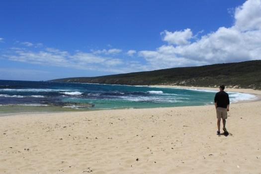 Man walks along the beach at Yallingup Australia