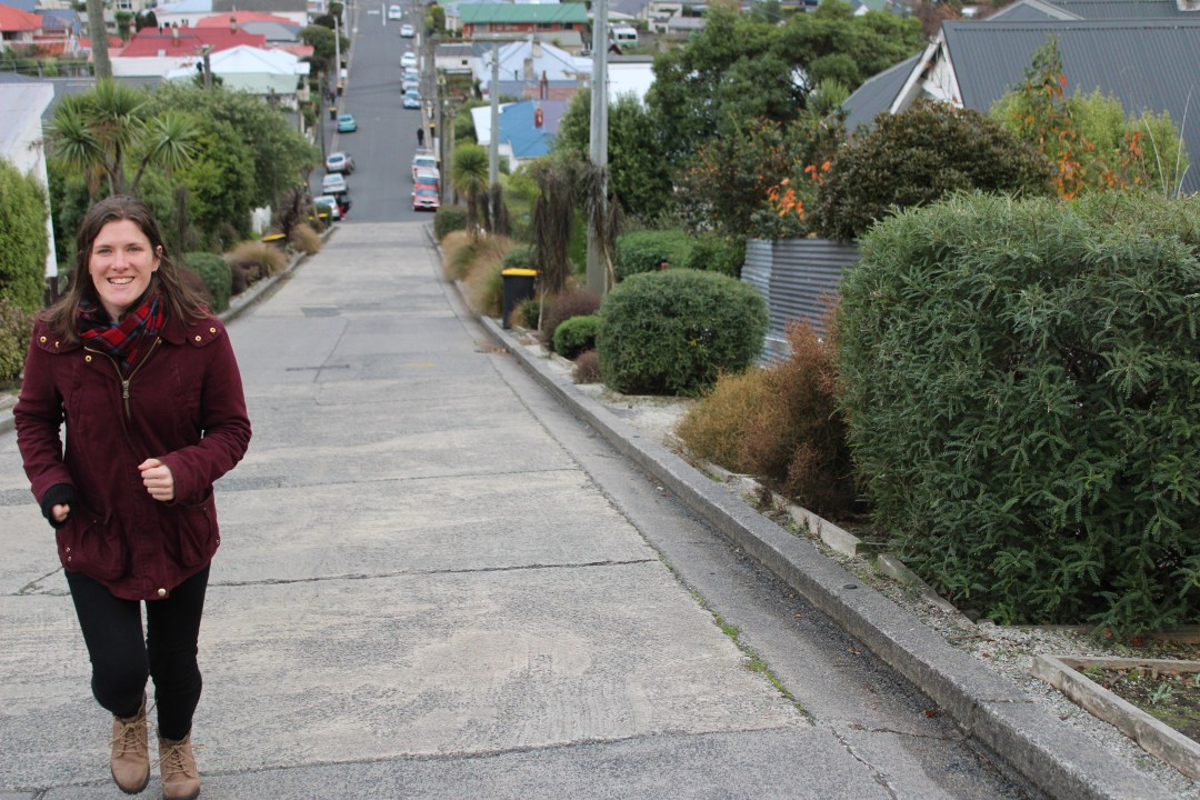 Girl runs uphill of Baldwin Street, Dunedin New Zealand