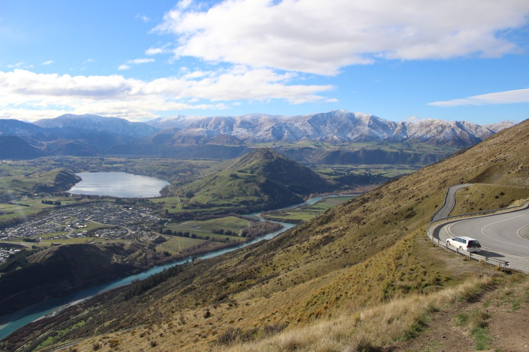 Sloping mountainsides with a winding road overlooking Queenstown New Zealand