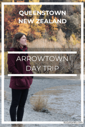 Pin title text of girl looking out at bright yellow and red trees in Arrowtown New Zealand