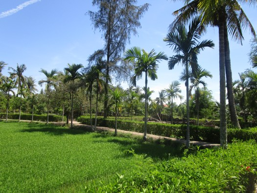 Historical Places to visit in Vietnam: My Lai Memorial. Where the memorial where the village once stood now is an expanse of trees and grass outside a museum.