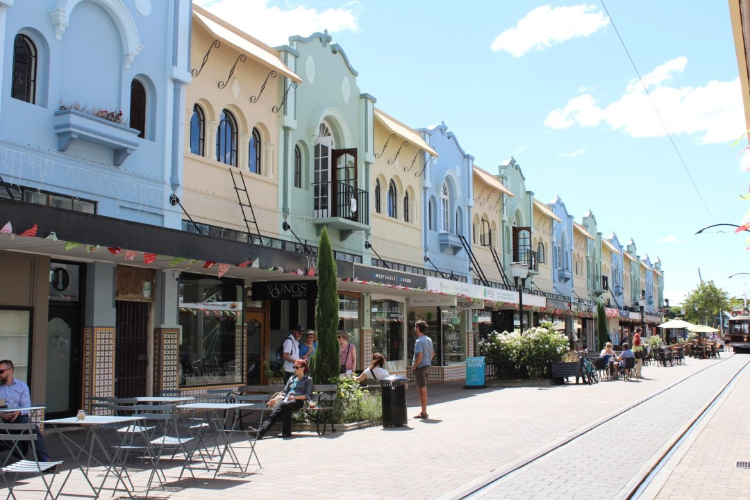 New Regent Street in Christchurch showing brightly coloured, art deco style shop fronts