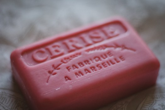 Close up of pink soap with french text printed into soap bar