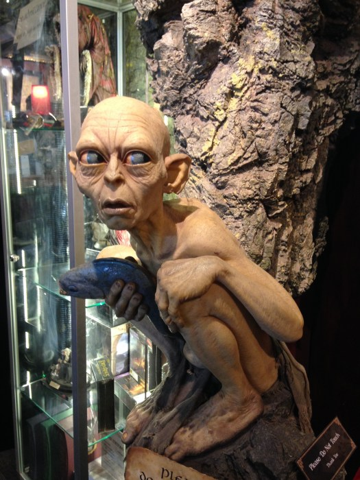 A statue of Gollum from Lord of the Rings perches in the museum of Weta Caves Wellington