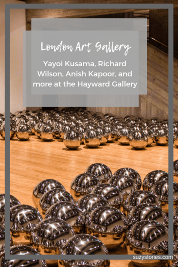 Silver balls scattered across the floor of art gallery