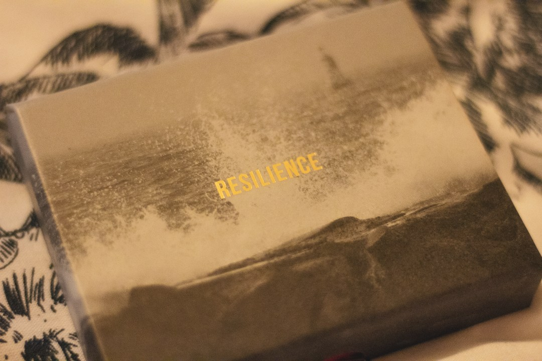Box with resilience embossed in gold writing