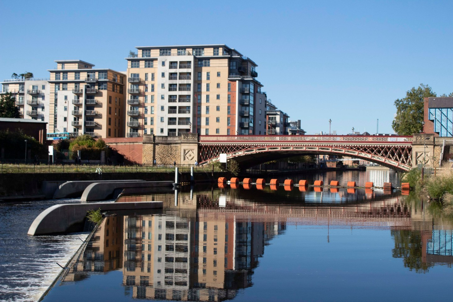 Bridge and still river on a sunny day in Leeds