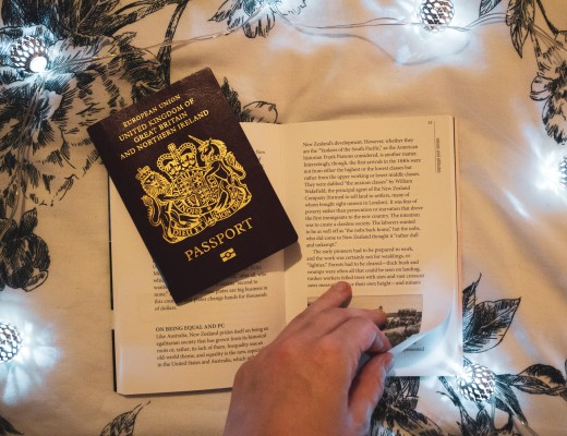 passport and turning page in book