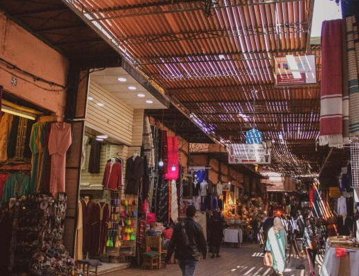 Marrakech souks with multiple souvenir stalls