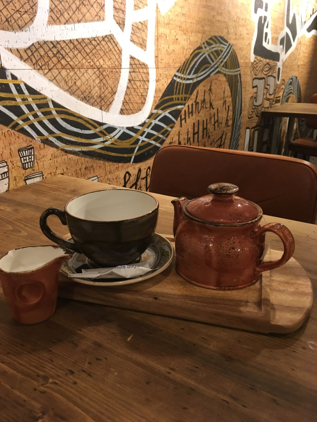 tea pot and cup in coffee shop
