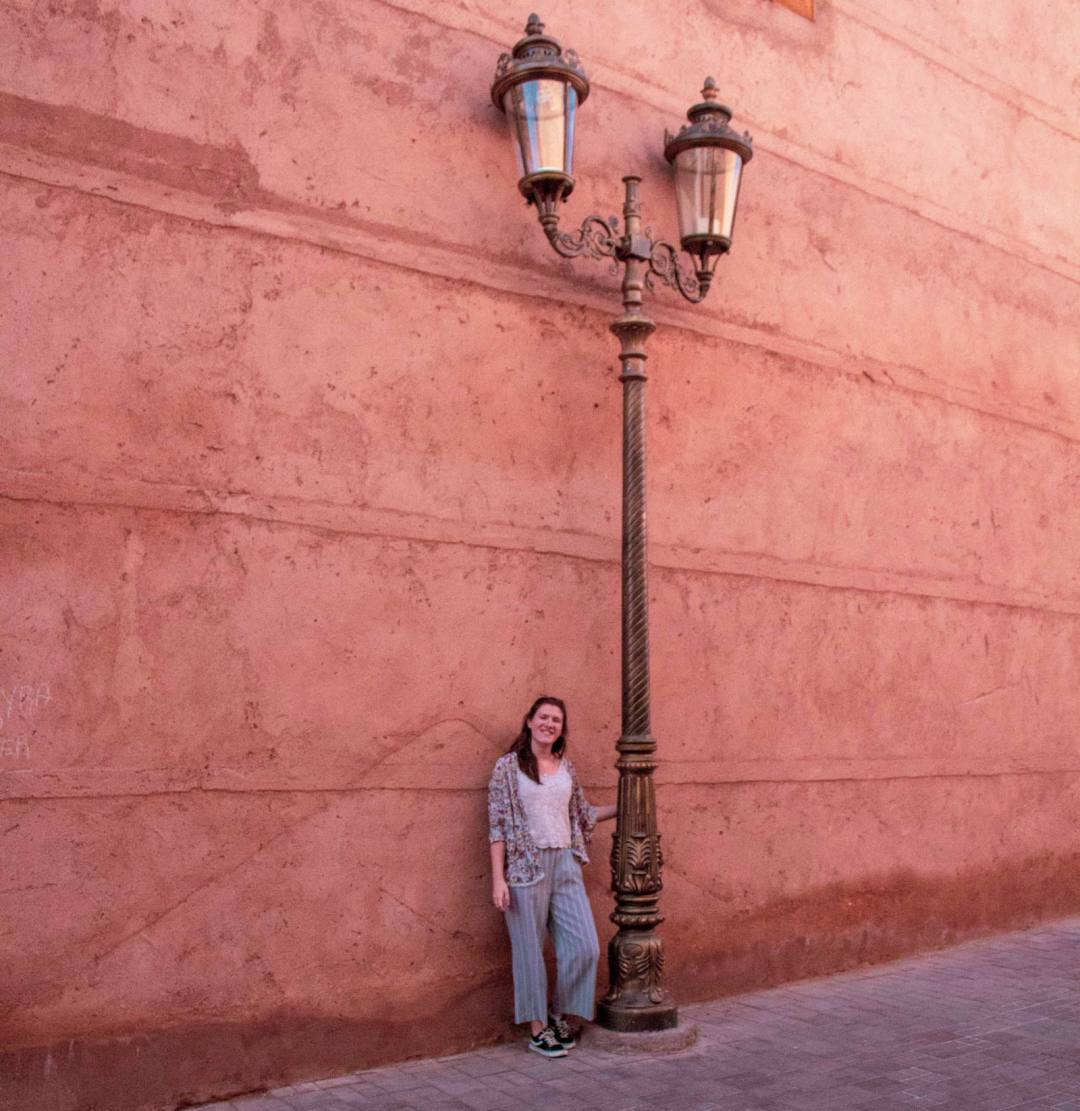 woman poses next to lamp post in Marrakech