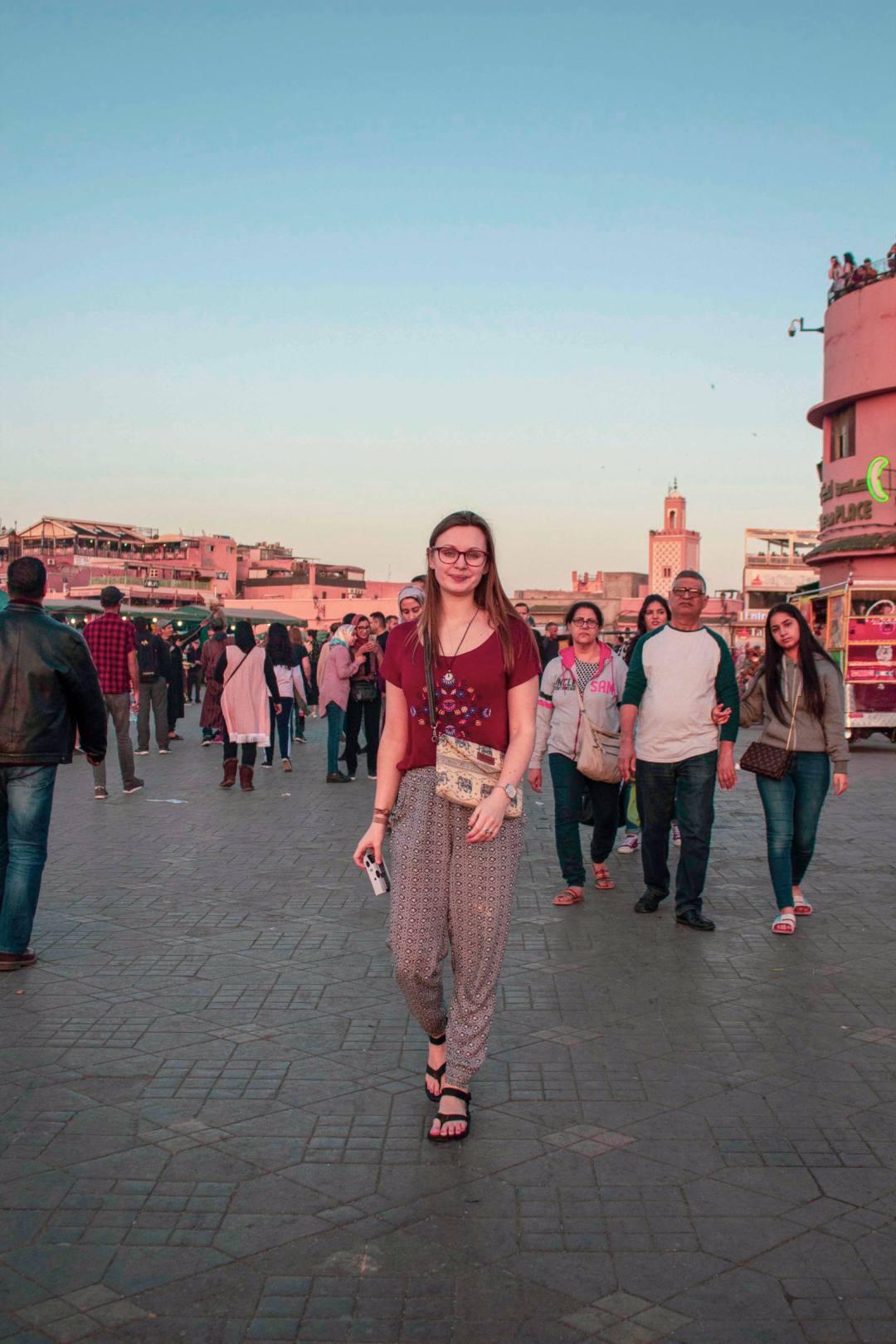 woman walks through Marrakech square
