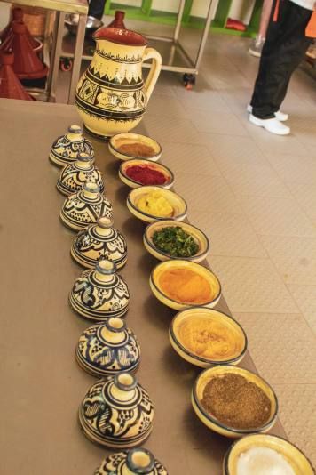moroccan spices lined up on table