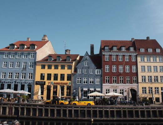 nyhavn area of copenhagen with colourful houses along canal