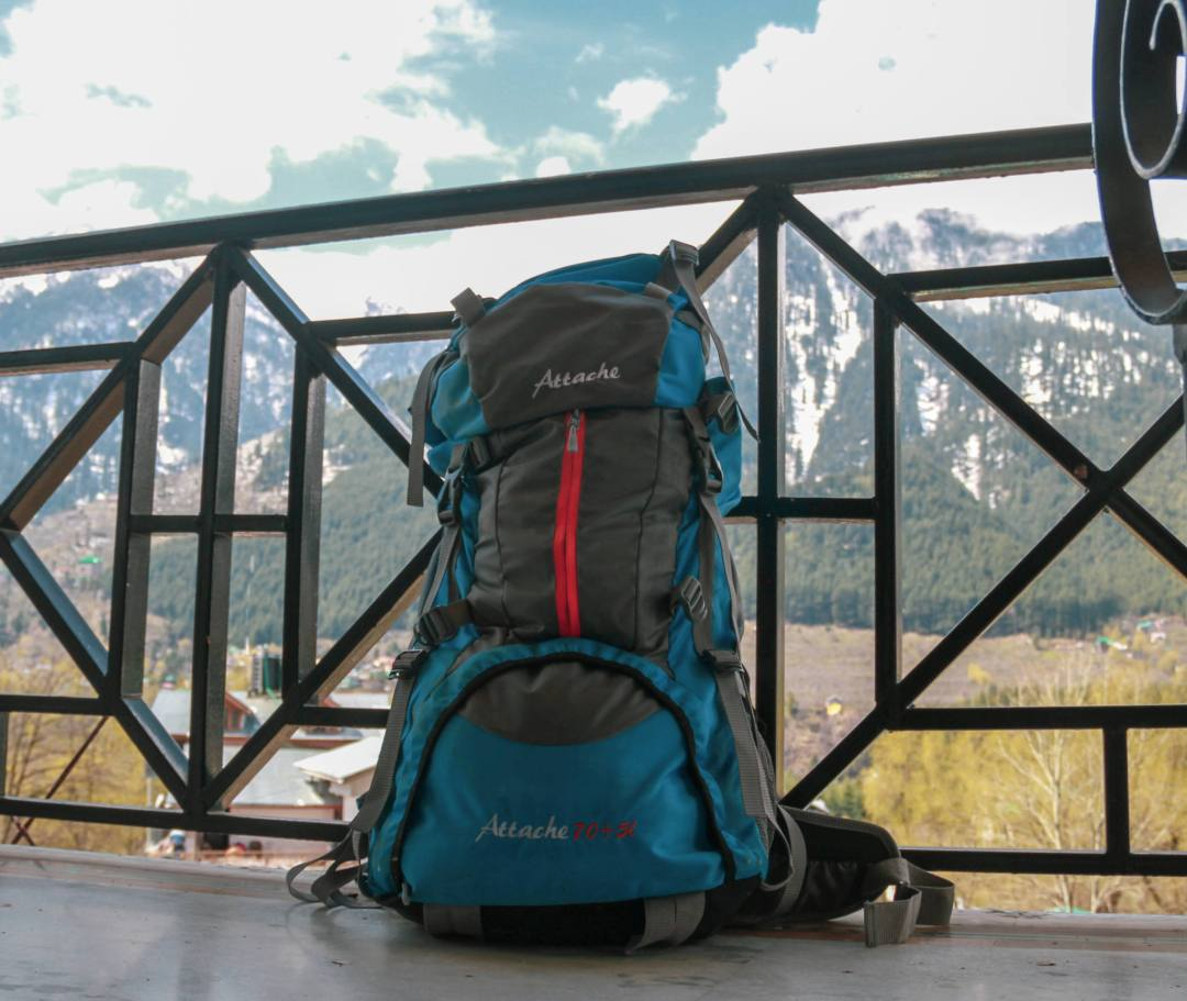 backpack ready for trek with mountains behind