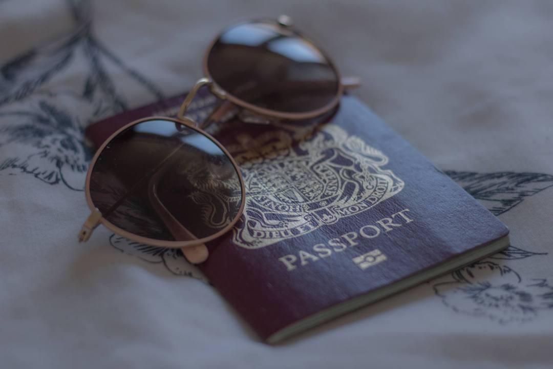 sunglasses on UK passport
