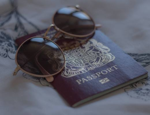 sunglasses on UK passport
