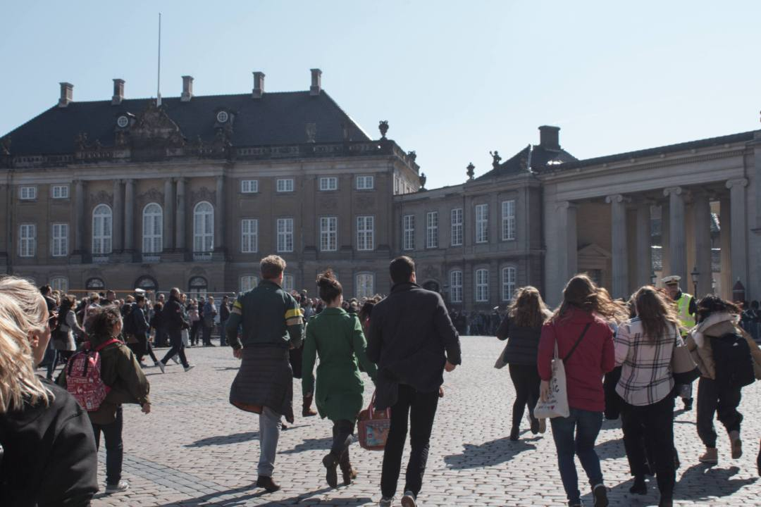 people running towards guards in Copenhagen