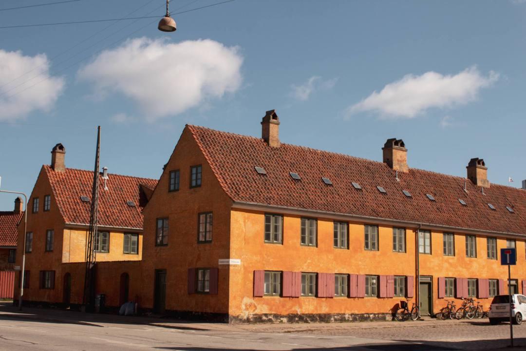 Terraced houses painted bright orange in Copenhagen