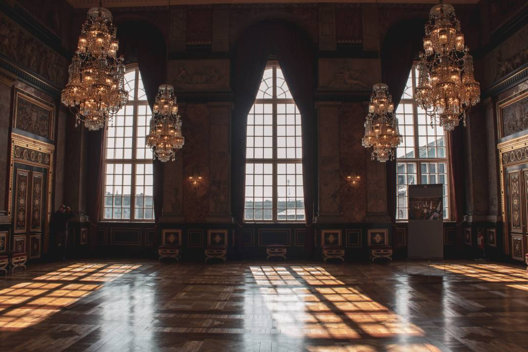 Large windows and chandeliers of Royal Rooms Copenhagen