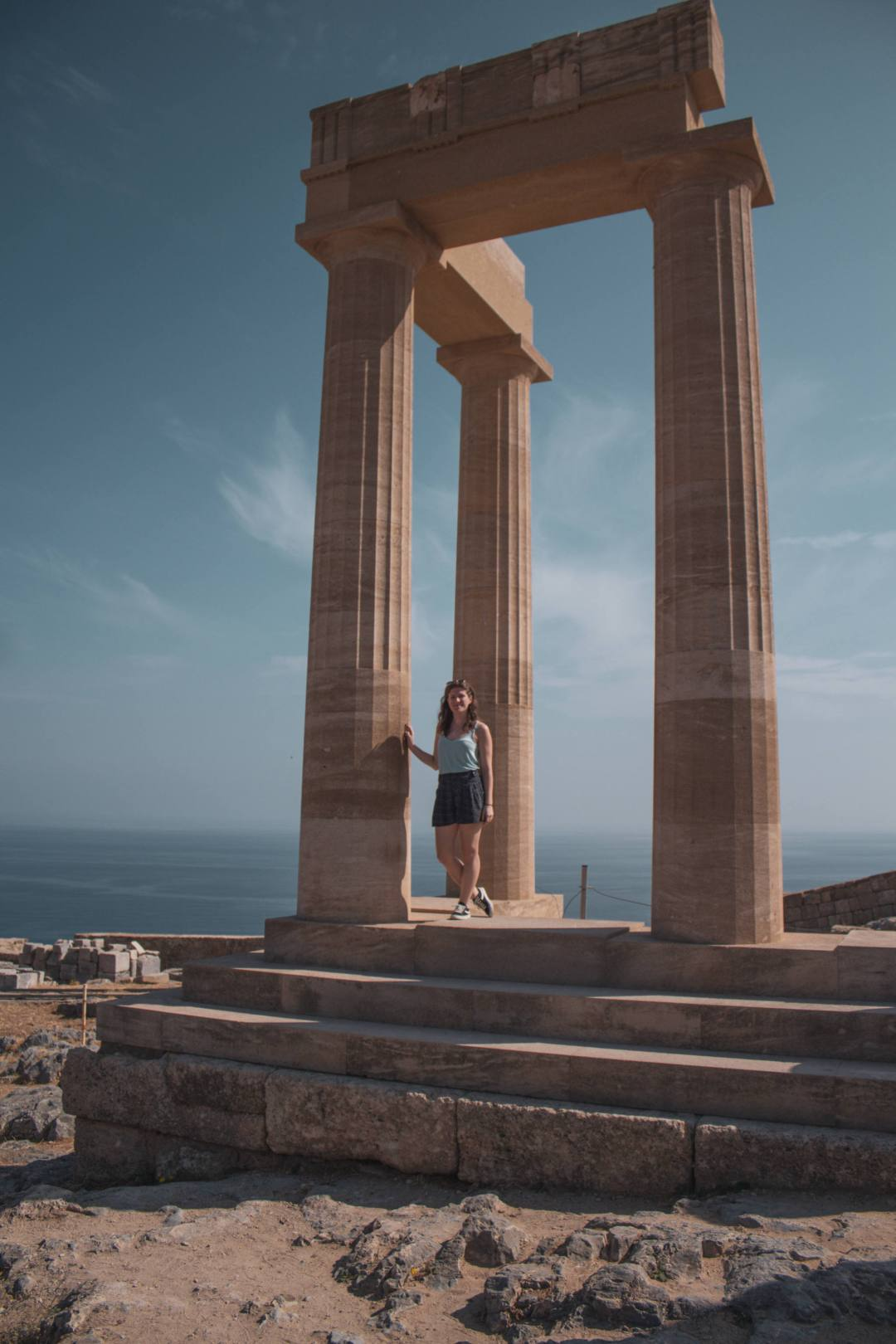 Woman stands at replica acropolis