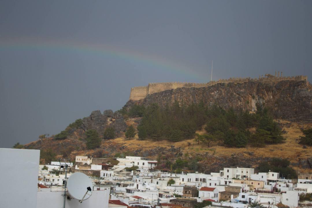 rainbow over Rhodes village and lindos acropolis