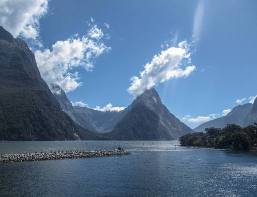 tall mountain in new zealand fjord