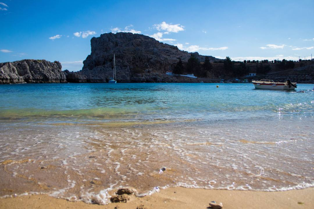 beach and coastal rocks at st pauls bay lindos