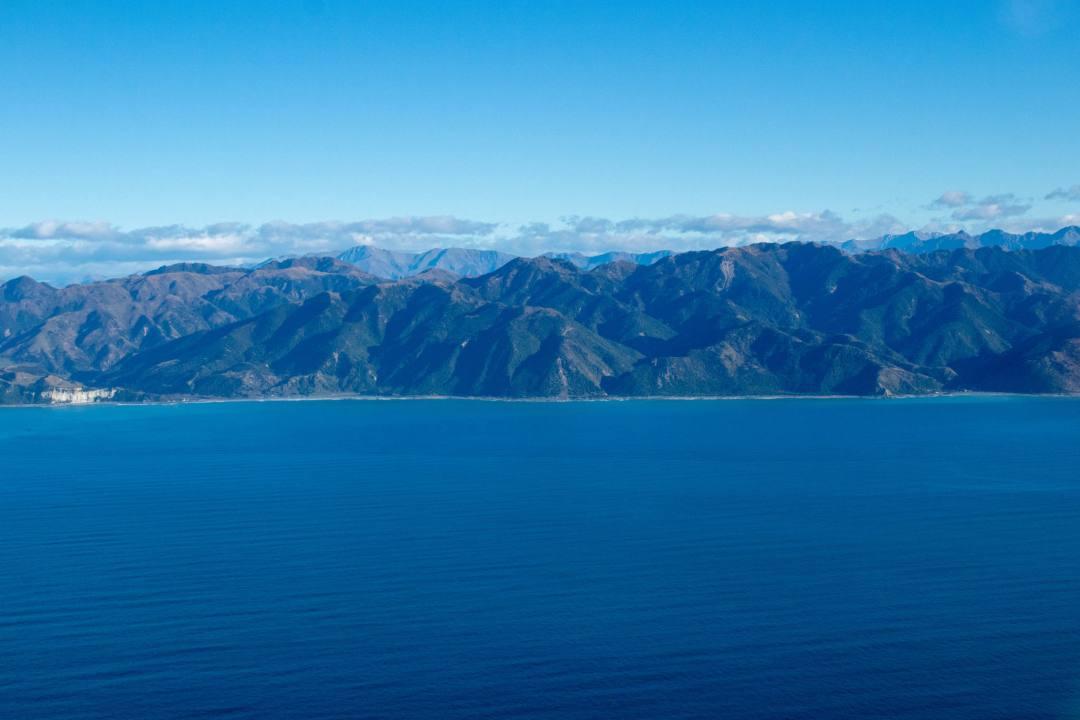 mountain coastline besides ocean