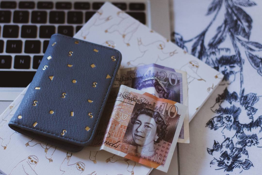 money and purse on notepad