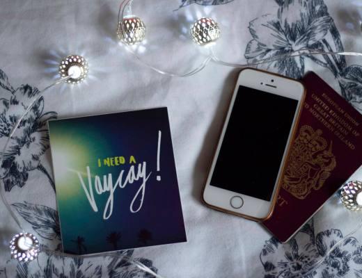 travel snob quote with phone and passport