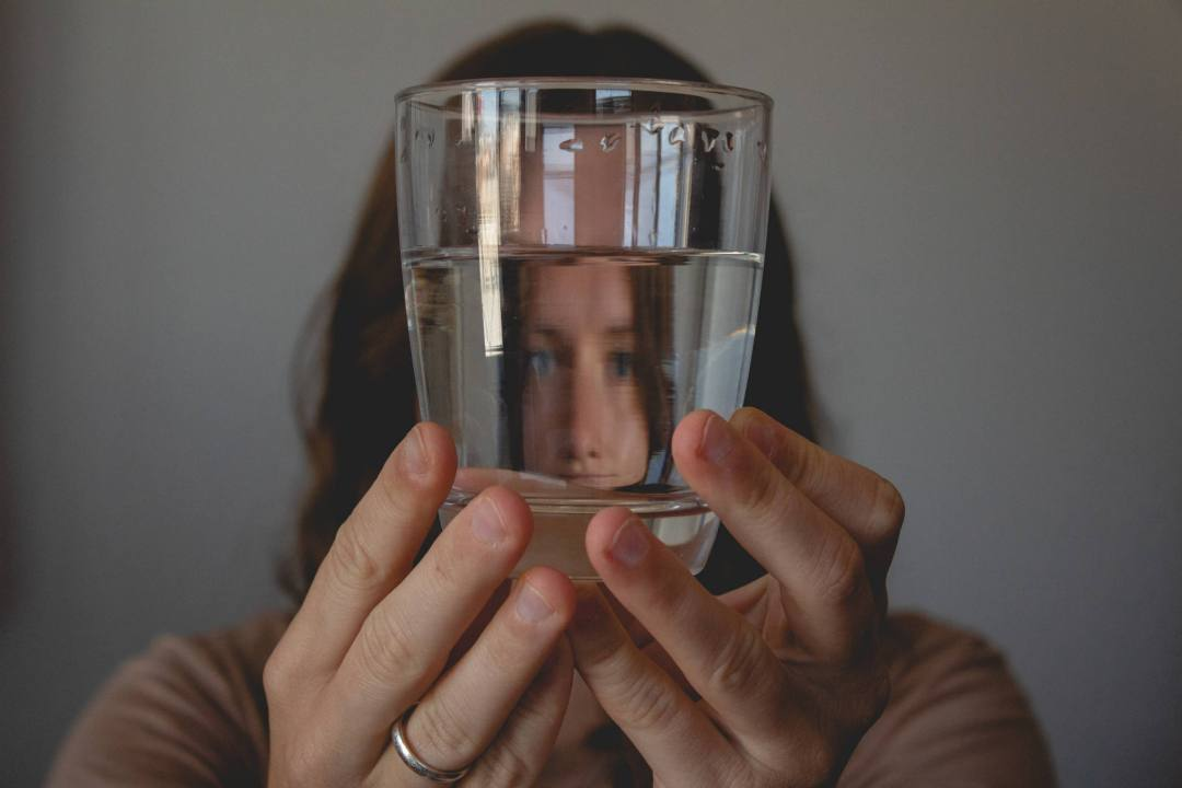 Woman holds glass of water