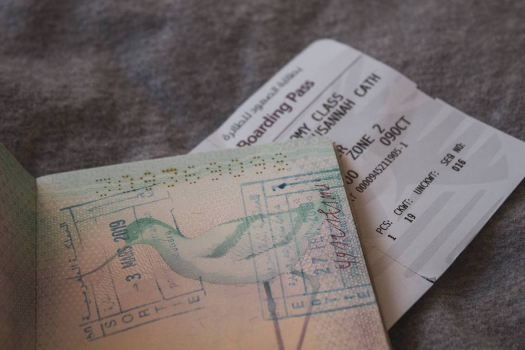 passport stamp and boarding pass