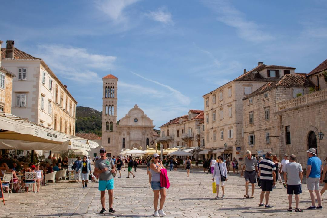 busy square with restaurants and shops in hvar