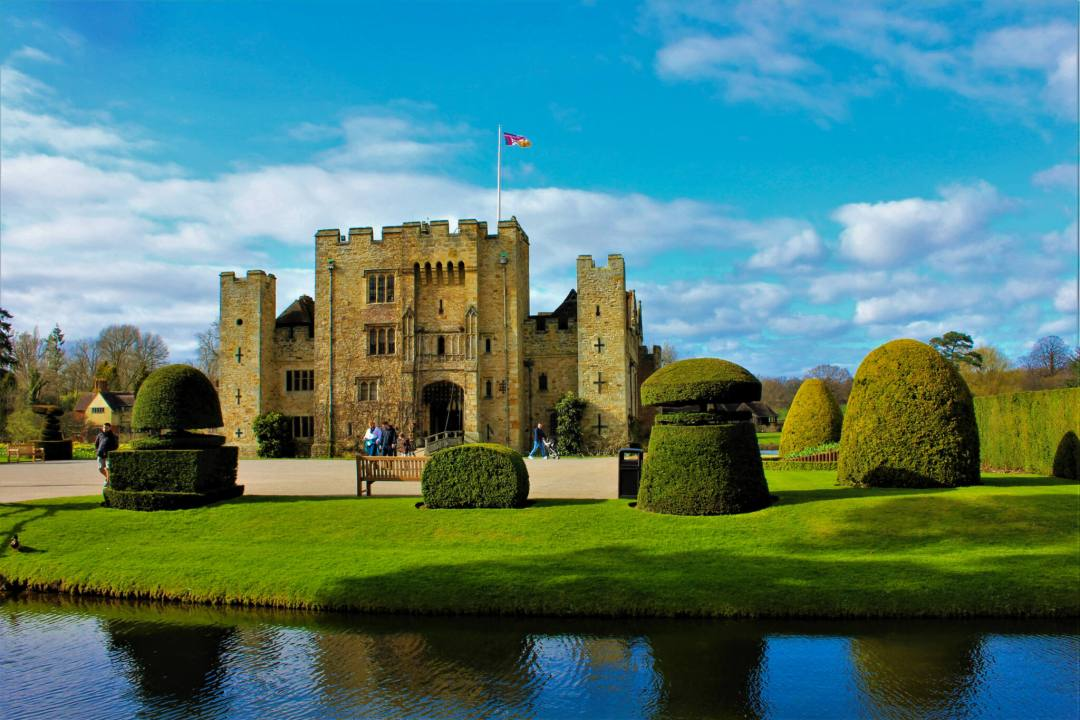 Exterior of Hever Castle and moat on sunny day