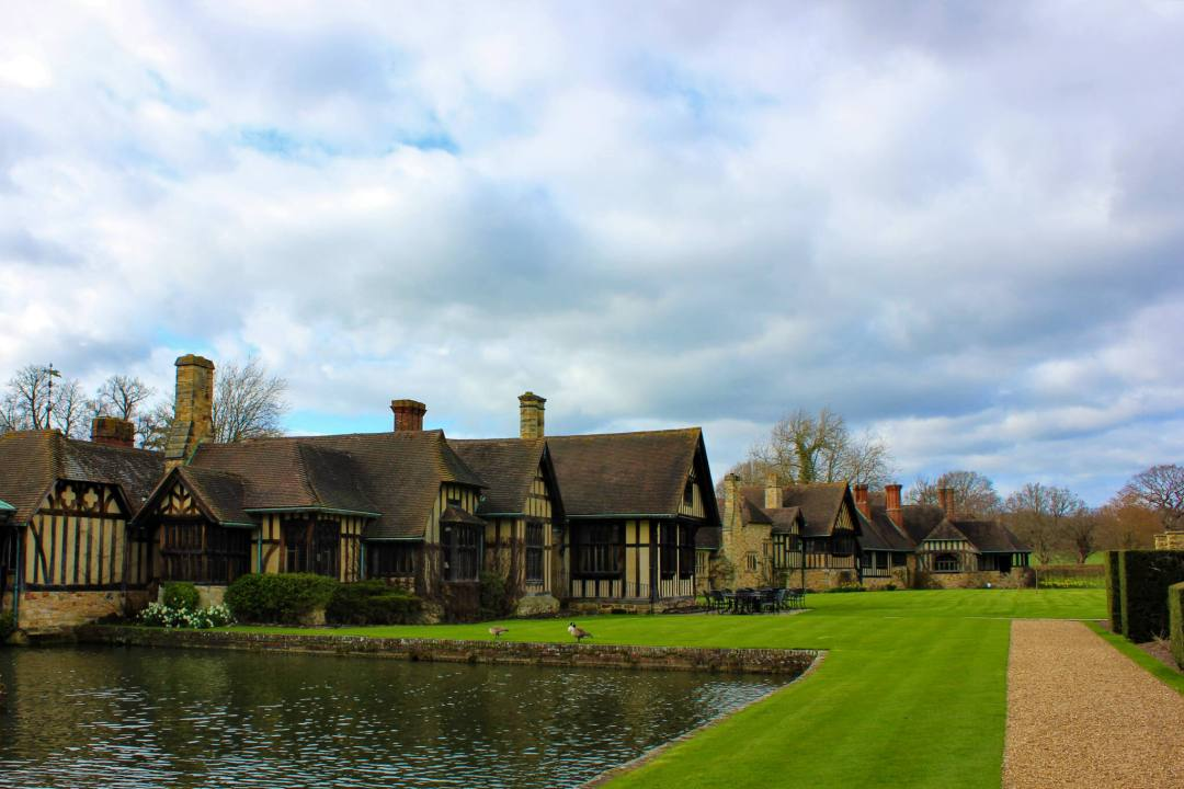 Tudor-style hotel accommodation surrounded by moat at Hever Castle
