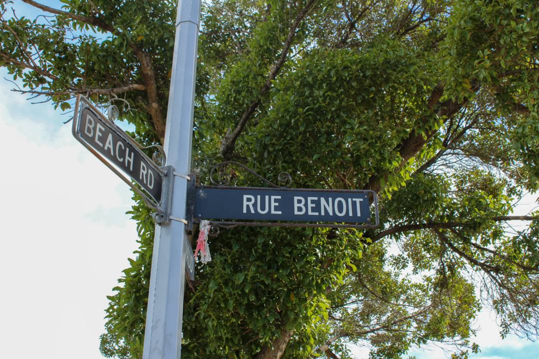 "Street sign saying ""Beach Road"" and Rue Benoit"" in Akaroa"