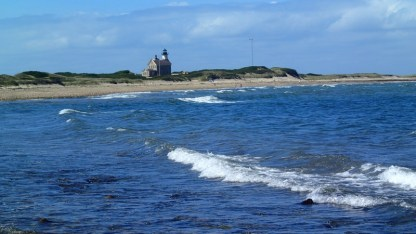 Looking across Cow Cove to Block Island north light. Charlie and Gwyn hiked almost there while Paul guarded the bikes (forgot the lock).