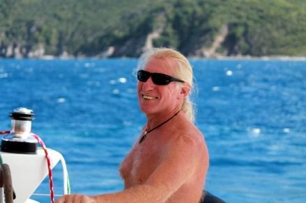 Paul happily sailing Blue Sky (courtesy of www.fraserrustics.com)