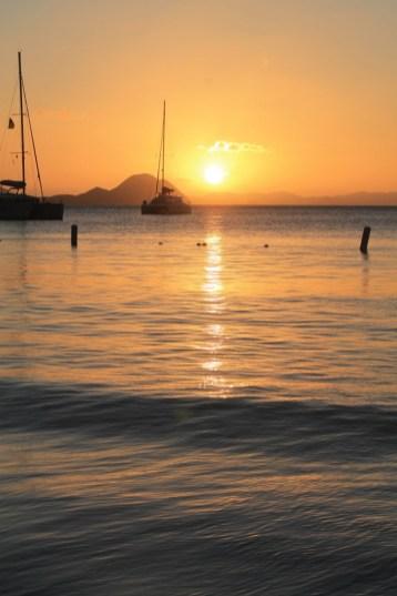 Sun heading down in Cane Garden Bay (courtesy of www.fraserrustics.com)